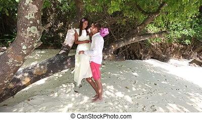 handsome groom carry his brunette bride