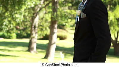 Handsome groom smiling at camera