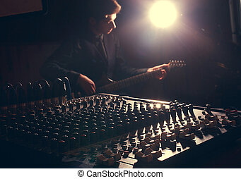 guitarist recording and playing guitar