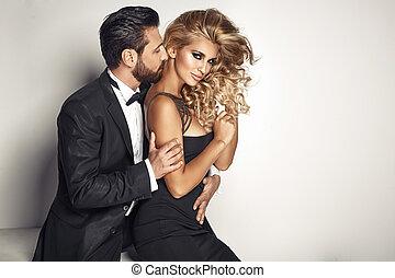 Handsome guy cuddling his beloved woman