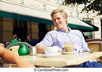 Handsome Guy Hanging Out in a Street Cafe