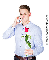 Handsome guy holding a red rose