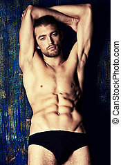 handsome guy - Sexual muscular nude man posing over dark...