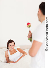Handsome guy with a rose and his girlfriend