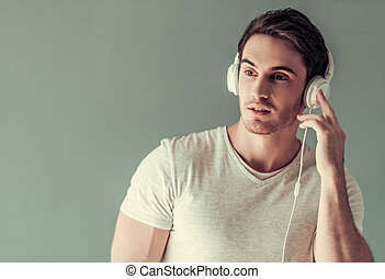 Handsome guy with gadget