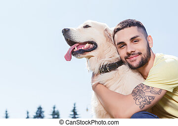 Handsome guy with his dog - Portrait of a handsome man...