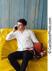 handsome guy with leather bag