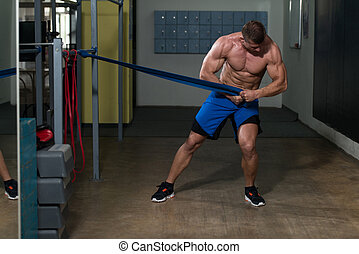 Handsome Guy Working Out With Rubber Band