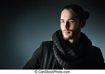 handsome - Handsome brunet man in black suit posing over...