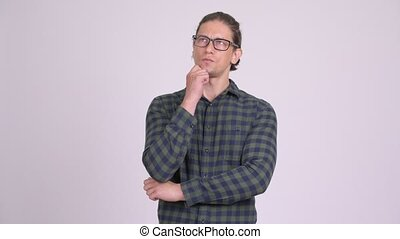 Handsome hipster man thinking and looking up - Studio shot...