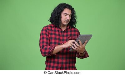 Handsome hipster man using digital tablet