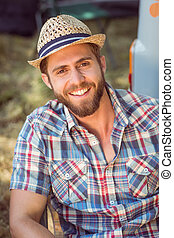 Handsome hipster smiling at camera