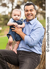 Handsome Hispanic Father and Son Posing for A Portrait in...