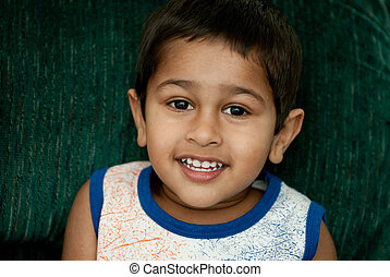 handsome indian kid looking very happy