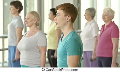 Handsome instructor - Focus on cheerful male ginger-haired...