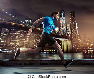 Handsome jogger running through the city in the night