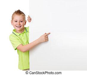 Handsome kid boy pointing to blank advertisement banner