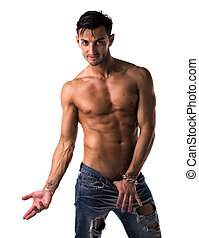 Handsome lean, shirtless man in jeans