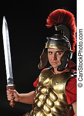 Handsome legionary soldier with a gladius