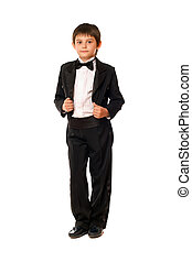 Handsome little boy in a tuxedo. Isolated on white