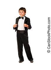Handsome little boy in a tuxedo