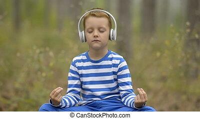 Handsome Little Boy Meditating