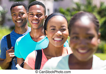 male african american student standing in a row