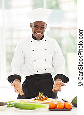male african chef presenting spaghetti