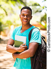 male afro american university student standing outdoors