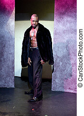 handsome male black african american actor pimp outfit on stage