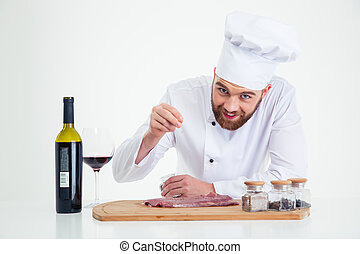 Handsome male chef cook preparing meat
