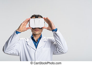 Handsome male doctor emerging in virtual world - Impressions...