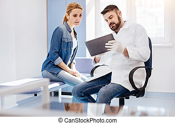 Handsome male doctor holding a tablet - Computer modeling....