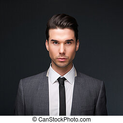 Handsome male fashion model in business suit