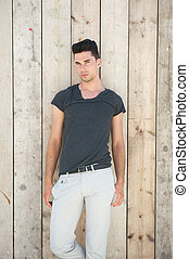 Handsome male fashion model standing outdoors