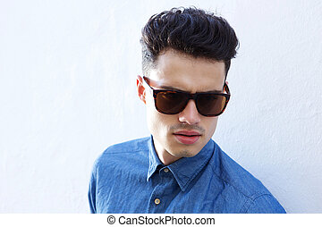 Handsome male fashion model with sunglasses