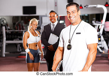 handsome male gym personal trainer