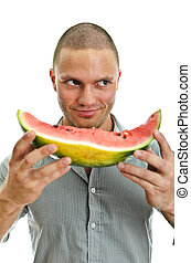 Handsome male holding watermelon. Isolated on white