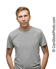 Handsome male in gray t-shirt isolated portrait
