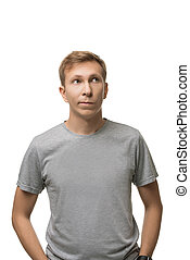 Handsome male in simple t-shirt isolated portrait