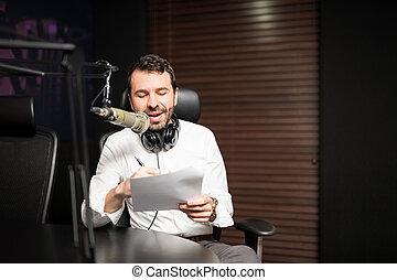 Handsome male radio host in studio