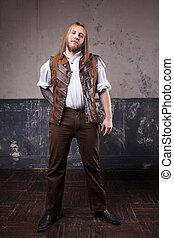Handsome male Steam punk. Retro man portrait over grunge...