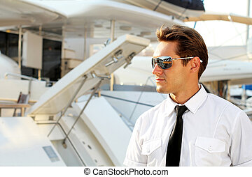 Handsome man, a serious captain in a white shirt near the...