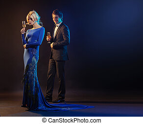 Handsome man and the woman wearing the evening gown -...