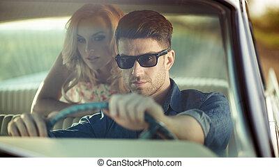 Handsome man as a retro driver