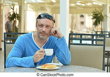 Handsome man at breakfast