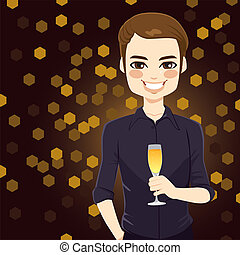 Handsome man enjoying glass of champagne on new year night club party