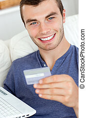 handsome man buying online