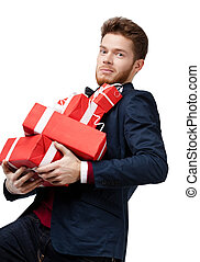 Handsome man carries a lot of presents