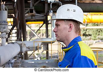 Handsome man constructor in helmet